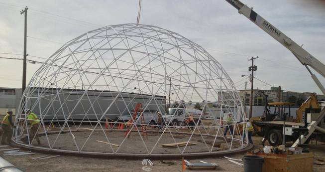 Workers put together the geodesic dome that will top the Downtown Project's Container Park at Seventh and Fremont streets.