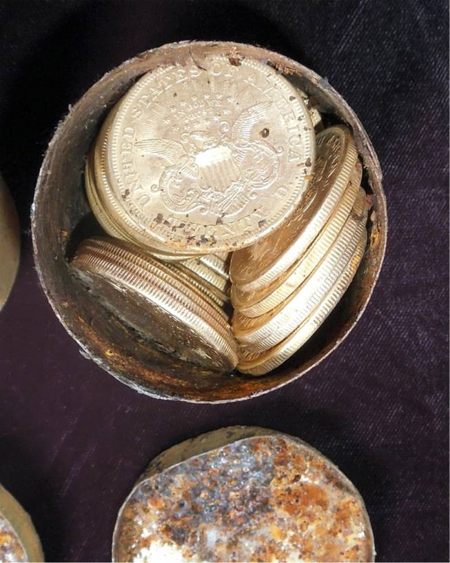 "This image provided by the Saddle Ridge Hoard discoverers via Kagin's, Inc., shows one of the six decaying metal canisters filled with 1800s-era U.S. gold coins unearthed in California by two people who want to remain anonymous.  The value of the ""Saddle Ridge Hoard"" treasure trove is estimated at $10 million or more."