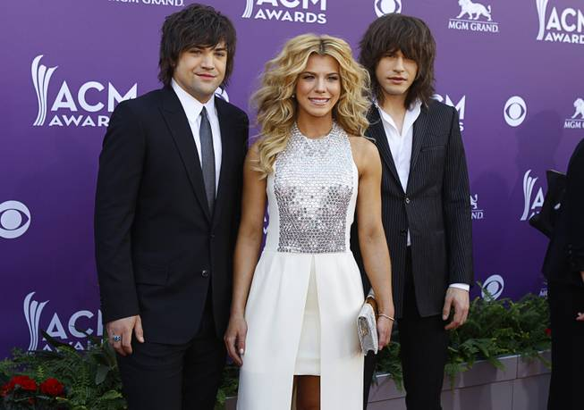 Neil Perry, Kimberly Perry and Reid Perry of The Band Perry arrive at the 48th ACM Awards at MGM Grand Garden Arena on Sunday, April 7, 2013.