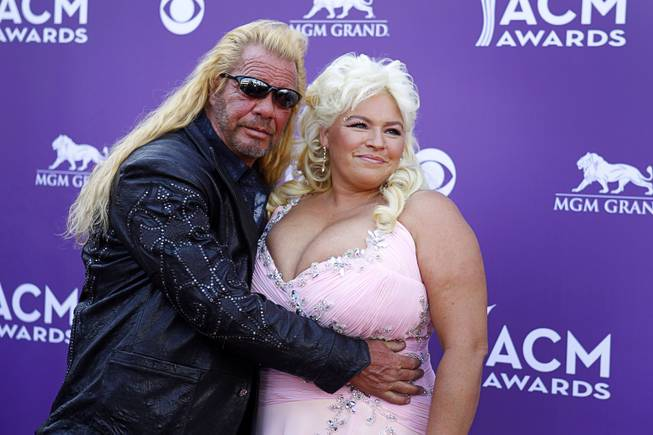 Bounty hunters Duane and Beth Chapman arrive for the 48th ACM Awards at the MGM Grand Sunday, April 7, 2013.