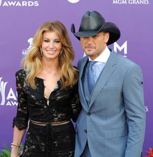 Faith Hill and Tim McGraw arrive at the 2013 Academy of Country Music Awards at MGM Grand Garden Arena on Sunday, April 7, 2013.