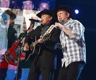 George Strait and Garth Brooks perform during the 2013 Academy of Country Music Awards at MGM Grand Garden Arena on Sunday, April 7, 2013.