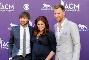 Lady Antebellum -- Dave Haywood, a very pregnant Hillary Scott and Charles Kelley -- arrives at the 2013 Academy of Country Music Awards at MGM Grand Garden Arena on Sunday, April 7, 2013.
