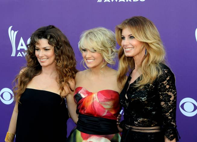 Shania Twain, Carrie Underwood and Faith Hill arrive at the 2013 Academy of Country Music Awards at MGM Grand Garden Arena on Sunday, April 7, 2013.