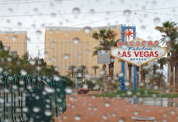 Rain falls on the Las Vegas Strip Monday, April 8, 2013. The National Weather Service reported that scattered showers and wind are expected through Tuesday.