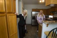 Fafie Moore, left, a Realty Executives owner/broker, and realtor Helen Riley look over a home being offered for sale in Henderson April 8, 2013.