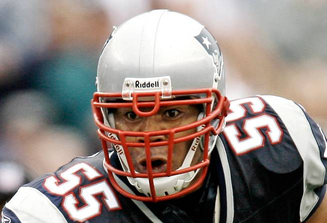 In this Oct. 7, 2007, file photo, New England Patriots linebacker Junior Seau runs with the ball after an interception during New England's 34-17 win over the Cleveland Browns in a football game at Gillette Stadium in Foxborough, Mass. A pair of wrongful-death lawsuits over the suicide of Seau have been consolidated with NFL concussion litigation in Philadelphia.