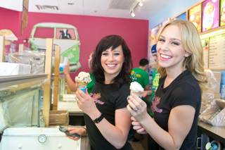 Natalie Walstead and Whitney Giron of X Burlesque hand out ice cream at Ben & Jerry's in The District at Green Valley Ranch during