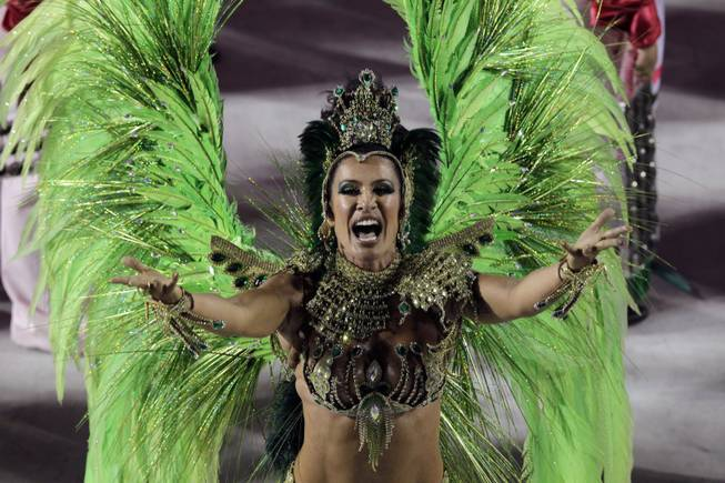 A performer from the Mangueira samba school parades during carnival celebrations at the Sambadrome in Rio de Janeiro, Brazil, Tuesday, Feb. 12, 2013.
