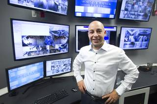 Christian Petrou, CEO and founder of Rvnue Technologies, poses in the Security Operations Center before a hi-tech security tour of the Panorama Towers Wednesday, April 10, 2013. Petrou designed the security system at the condo towers. The tour was held in conjunction with the International Security Conference & Exposition (ISC West)  taking place at the Sands Expo Center.