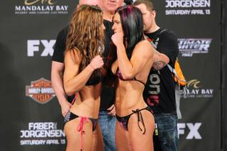 Miesha Tate, left, and Cat Zingano face off during weigh ins for The Ultimate Fighter 17 finale Friday, April 12, 2013.