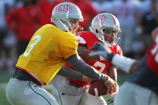 UNLV quarterback Nick Sherry hands off to Adonis Smith during their spring football game Friday, April 12, 2013.