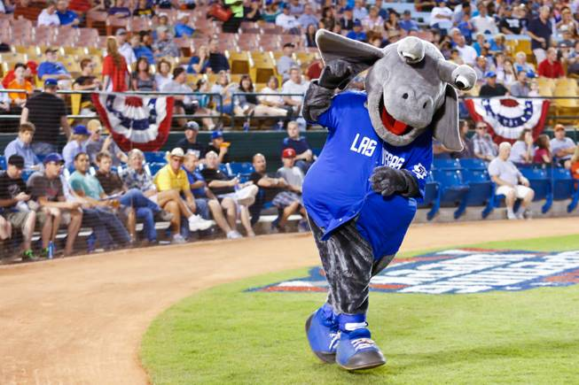 Las Vegas 51's mascot Cosmo takes the field, Friday April 12, 2013.