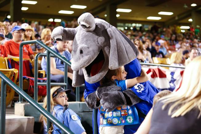 A young baseball fan recieves a hug from Cosmo during the opening game for the Las Vegas 51's against the Colorado Springs Sky Sox at Cashman Field, Friday April 12, 2013.