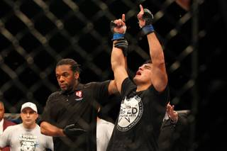 Kelvin Gastelum rejoices as he is the announced winner of a split decision over Uriah Hall to win The Ultimate Fighter 17 Finale Saturday, April 13, 2013 at the Mandalay Bay Events Center.