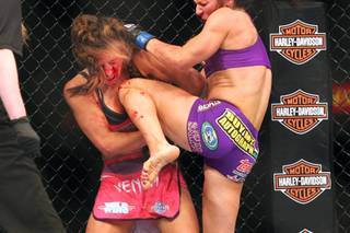 Cat Zingano pounds Miesha Tate with knees on her way to a third round TKO during their bout at The Ultimate Fighter 17 Finale Saturday, April 13, 2013 at the Mandalay Bay Events Center.