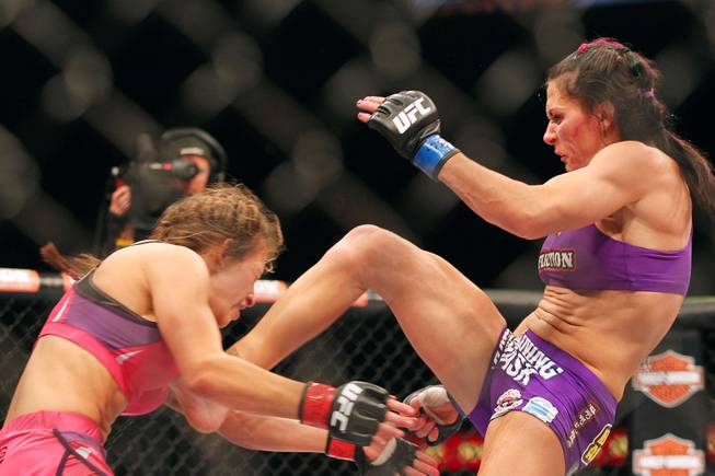 Cat Zingano lands a kick to the midsection of Miesha Tate during their bout at The Ultimate Fighter 17 Finale Saturday, April 13, 2013 at the Mandalay Bay Events Center. Zingano won with a third round TKO.