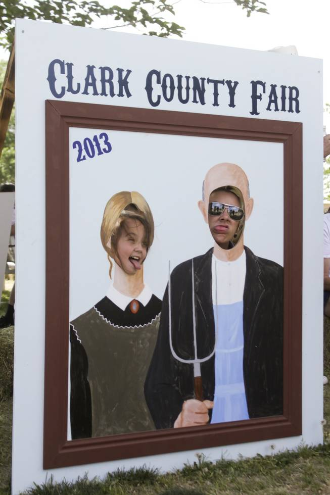 "Arlene, left, and Bobbie stop to take a photo as the characters of Grant Wood's ""American Gothic"" painting at the 2013 Clark County Fair, Saturday, April 13, 2013."