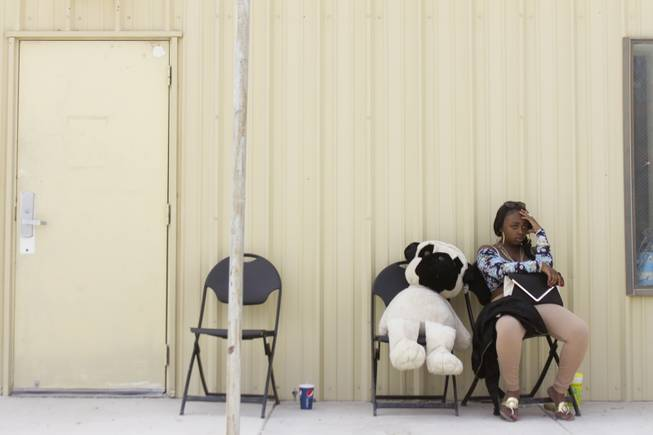 A fair goer takes a break at the 2013 Clark County Fair, Saturday, April 13, 2013.