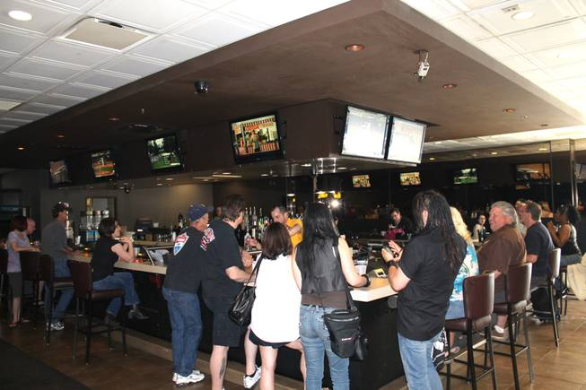 Patrons hit the bar at Gold Spike on the casino's final day of operations in downtown Las Vegas.