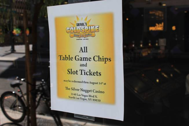 A sign on the door directs gamblers on where to cash in chips and tickets fro the Gold Spike.