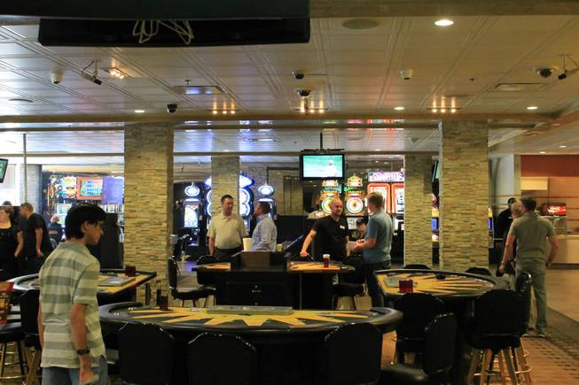 Blackjack tables sit empty on the afternoon of the closing of Gold Spike in downtown Las Vegas.