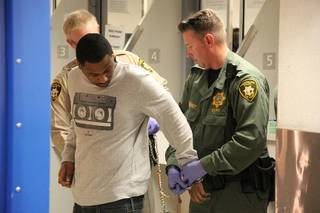 Ammar Harris is brought to the Clark County Detention Center on April 16, 2013, to be booked on charges related to a shooting and fiery crash on the Las Vegas Strip in which three people were killed Feb. 21, 2013.