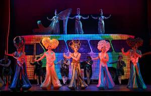 "Performers -- and Priscilla -- are all aglow in ""Priscilla, Queen of the Desert -- The Musical."""