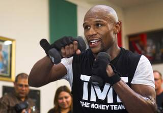 Undefeated welterweight boxer Floyd Mayweather Jr. works out at the Mayweather Boxing Club Wednesday, April 17, 2013. Mayweather will defend his WBC welterweight title against Robert Guerrero at the MGM Grand Garden Arena on May 4.