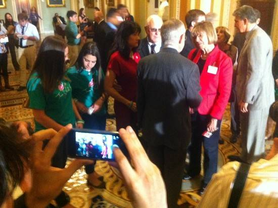 U.S. Sen. Harry Reid meets with gun violence survivors after gun control votes in the U.S. Senate on Wednesday, April 17, 2013.