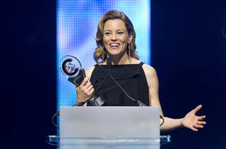 Actress Elizabeth Banks accepts the Award of Excellence in Acting during the 2013 CinemaCon Awards at The Colosseum in Caesars Palace on Thursday, April 18, 2013.