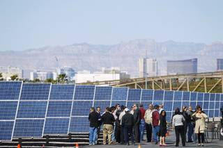Guests and media gather as the City of Las Vegas dedicates its new three-megawatt solar panel installation Thursday, April 18, 2013.