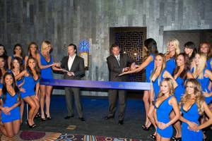 Neil Moffitt, CEO of Angel Management Group, and Scott Sibella, president and COO of MGM Grand, celebrate the opening of Hakkasan Las Vegas with a ceremonial ribbon cutting Thursday, April 18, 2013.