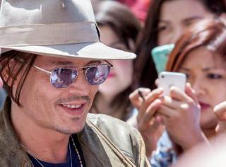 Johnny Depp departs Town Square after a sneak preview of his new film