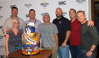 Kenny Chesney, center, celebrates the fourth anniversary of The Joint in The Hard Rock Hotel on Friday, April 19, 2013.