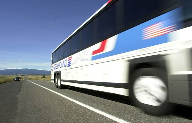 A Greyhound bus whizzes down Highway 97 south of Goldendale, Wash.