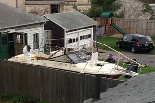 Investigators work near the location, on Saturday, April 20, 2013, in Watertown, Mass., where the previous night a suspect in the Boston Marathon bombings was arrested. Police captured Dzhokhar Tsarnaev, 19, the surviving Boston Marathon bombing suspect, in a backyard boat after a wild car chase and gun battle earlier in the day left his older brother dead. (AP Photo/Katie Zezima)