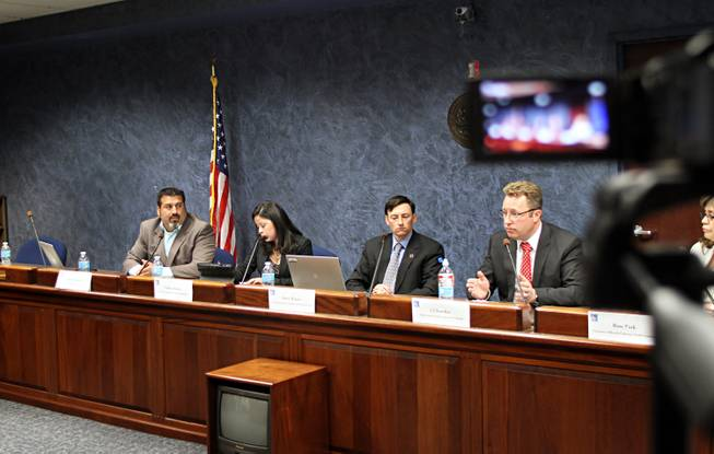 (L-R) Andres Ramirez, Know Your Care, Liliana Ranon, League of United Latin American Citizens, and Steve Wiener of the U.S. Department of Health and Human Services listen in as CJ Bawden, communications director for Nevada Health Link, answers a question posed by an attendee at the LULAC Health Care Town Hall Tuesday April 23, 2013 at the Grant Sawyer State Building in Las Vegas.