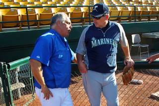 Former Mets teammates Las Vegas 51's manager Wally Backman, left, and Tacoma Rainiers hitting coach Howard Johnson talk before their game Thursday, April 25, 2013.