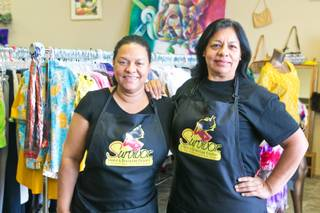 Rebeca Ferreira and Francisca Torres, both survivors of domestic violence, stand inside their thrift shop Survivor Store and Training Center, Thursday, April 25, 2013. The secondhand store helps victims of domestic violence by training them to find employment and become financially independent.