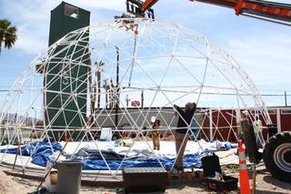 Workers install a fabric sheet on a geodesic dome that will become part of the Downtown Container Park near Seventh and Fremont streets.