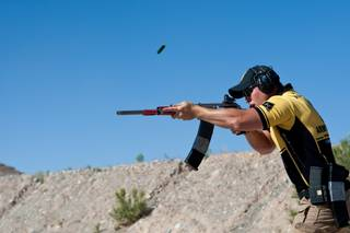 Sgt. Shane Coney, U.S. Army Marksmanship Unit, using his customized Russian-made 12-gauge shotgun competes in the 2013 United States Practical Shooting Association Multi-gun National Championship at Desert Sportsmen in Las Vegas, Sunday, April 28, 2013.