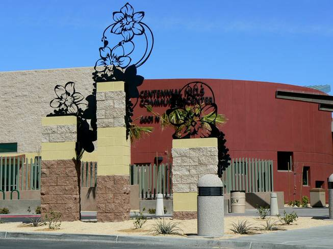 """Bear Poppy,"" by Jeff Fulmer-Three hand cut metal silhouettes greets visitors at the front entrance of Centennial Hills Leisure Center located in northwest Las Vegas."