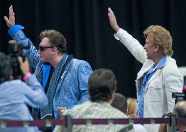 "Siegfried & Roy acknowledge the crowd at the 10th ""Best in Show"" canine adoption event at Orleans Arena."
