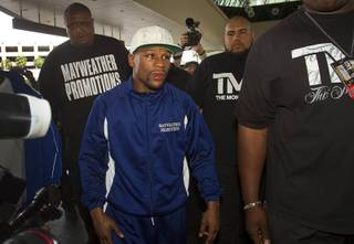 Undefeated welterweight boxer Floyd Mayweather Jr. makes his official arrival at the MGM Grand Tuesday, April 30, 2013. Mayweather will defend his WBC welterweight title against Robert Guerrero at the MGM Grand Garden Arena on Saturday.