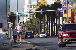 Adam Towle, 37, of Solana Beach, Calif. runs the third segment of the MS Run the US, a 3,000 mile relay run from Los Angeles to New York City, in downtown Las Vegas Tuesday, April 30, 2013. MS Run the US is a non-profit organization committed to raising disease awareness and funds to further research in the fight to end multiple sclerosis (MS).