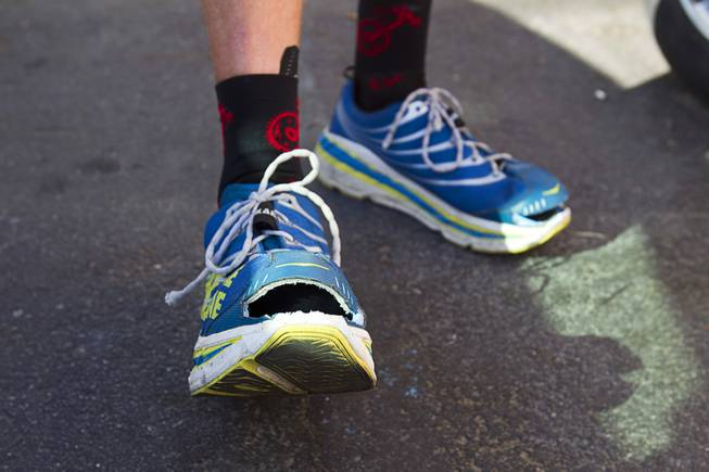 Adam Towle, 37, of Solana Beach, Calif. displays his shoes during the third segment of the MS Run the US, a 3,000 mile relay run from Los Angeles to New York City, in Las Vegas Tuesday, April 30, 2013. Towle said he cut the toes of his running shoes so that he can continue to run even if his feet swell. MS Run the US is a non-profit organization committed to raising disease awareness and funds to further research in the fight to end multiple sclerosis (MS).
