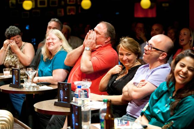 Audience members crack up laughing as comedians heckle front-row guests at Brad Garrett's Comedy Club in Las Vegas Tuesday, April 30, 2013.