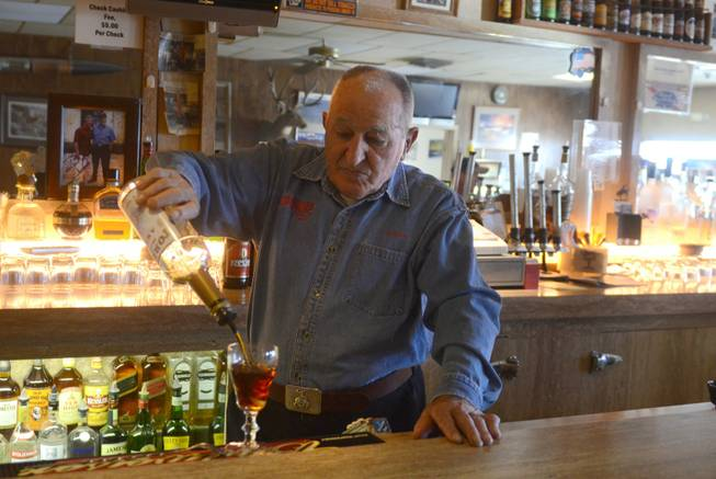 Bruno Selmi makes a Picon Punch behind the bar Bruno's Country Club in Gerlach, Nev.