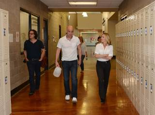 Andre Agassi gives husband-and-wife Davis Guggenheim and Elisabeth Shue a tour of Andre Agassi College Preparatory Academy in Las Vegas on Tuesday, April 30, 2013.